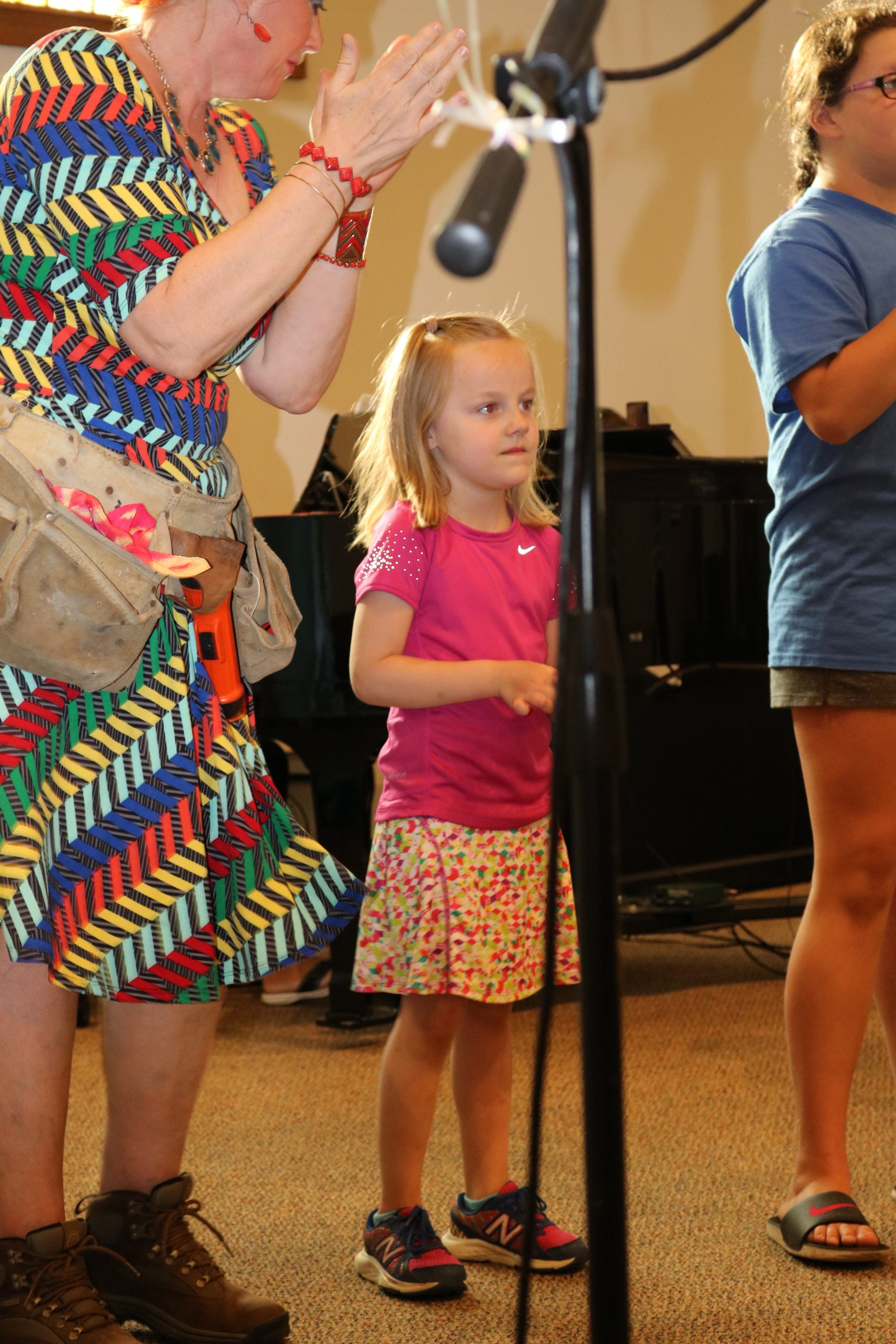Little girl next to microphone